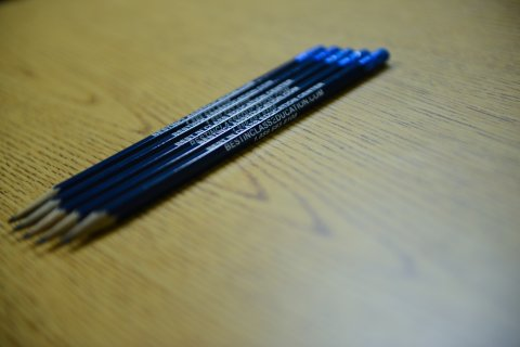A picture of 5 blue BIC pensils