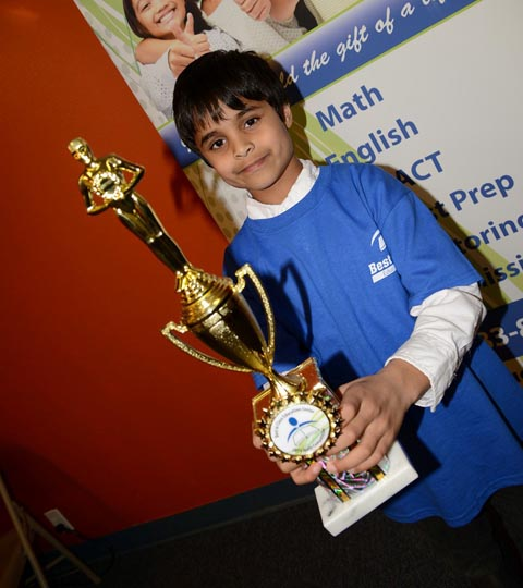 Math competition winner shows his trophy