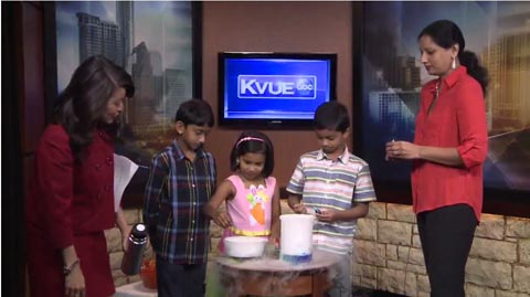 Aruna with students and dry ice experiments
