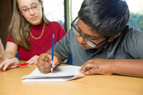 A student works on a packet.